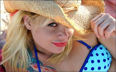 blond woman with cowboy hat